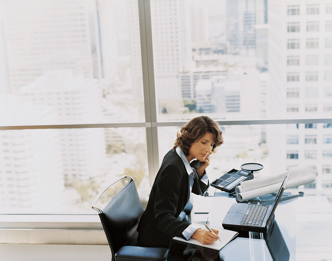 Professional Woman Working in High Rise Office